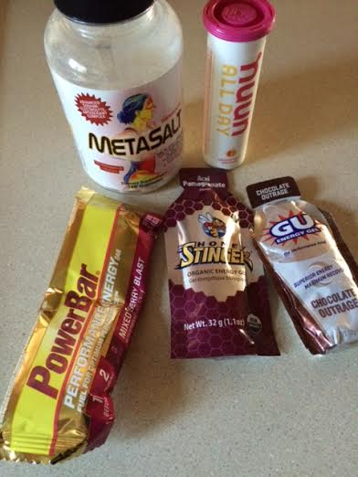 Five food products used in endurance racing: Metasalt tablets, Nuun electrolyte hydration, Powerbar, Honey Stinger gel, Gu gel
