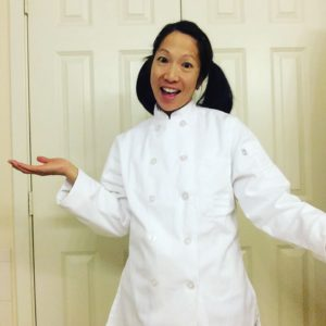Author wearing white double button chef's coat.