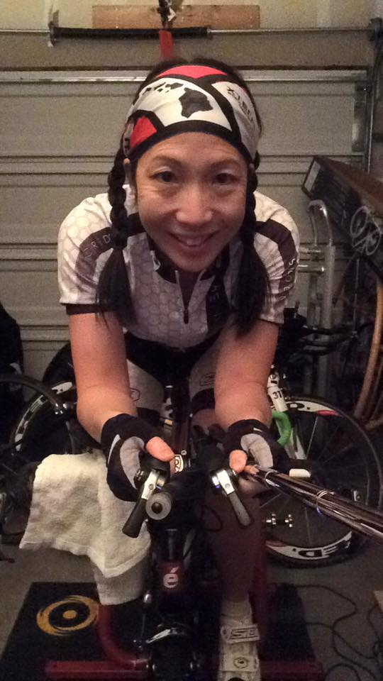 Author holding aerobars of a bike, smiling at the camera!