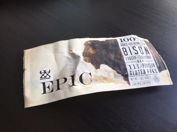 EPIC Bison bar laying on a dark brown coffee table