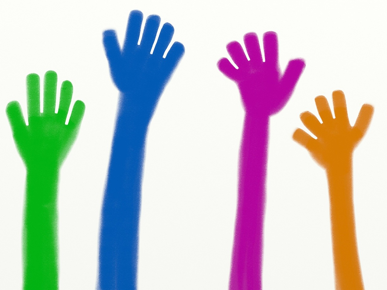 Cartoon hands in green, blue, purple, and brown raised in the air.