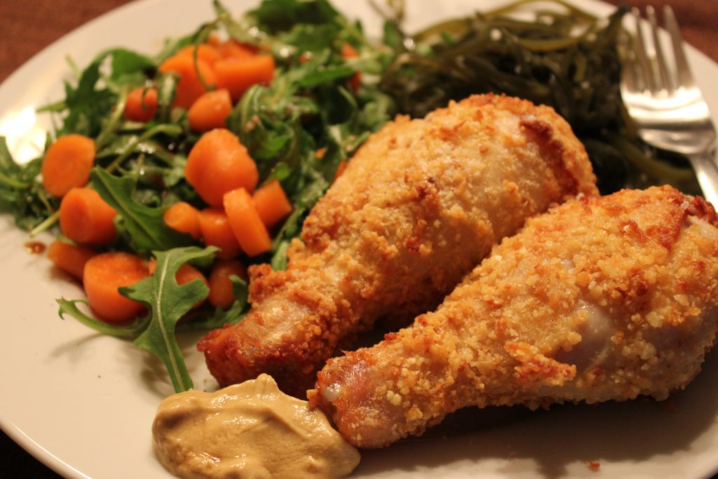 Baby arugula salad with carrot, sea kelp shreds, two chicken drumsticks air fried with Panko crumbs on the outside. Photo by Imei.
